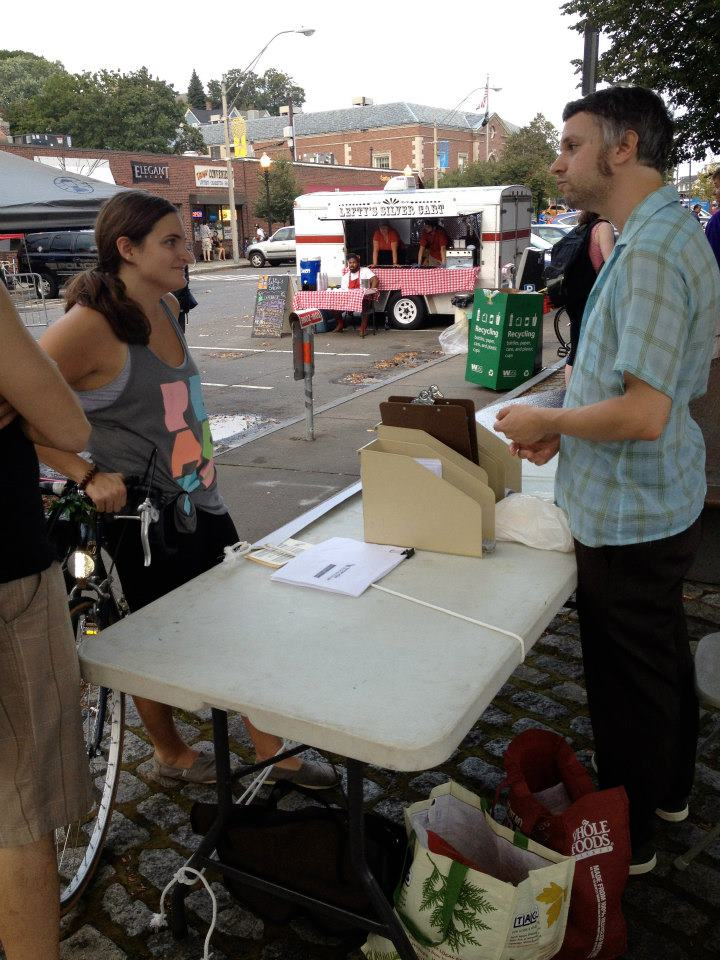 Talking about community at a street fair. (Photo by Jacy Edelman)