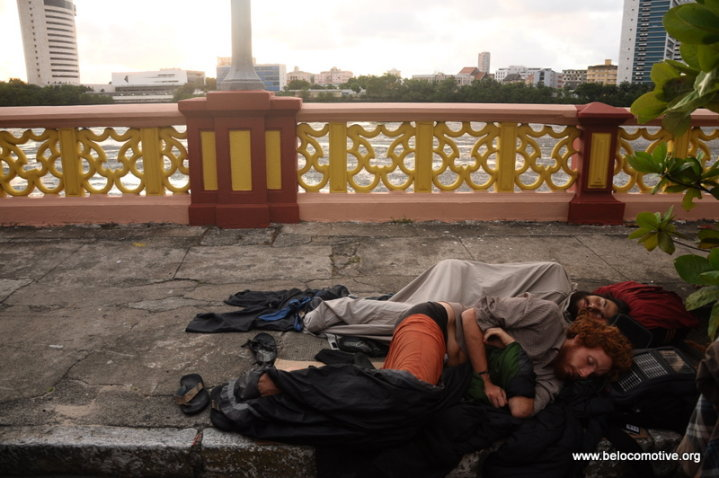 Nicola Zolin and Benjamin Lesage sleeping on the sidewalk in Recife, Brazil.