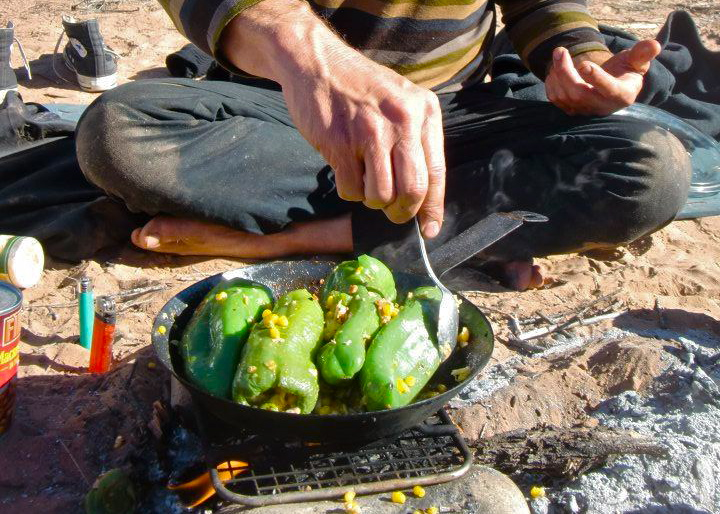 Suelo fixes chile rellenos from dumpster-salvaged ingredients. Photo by Ried Stewart Waring Meyer.