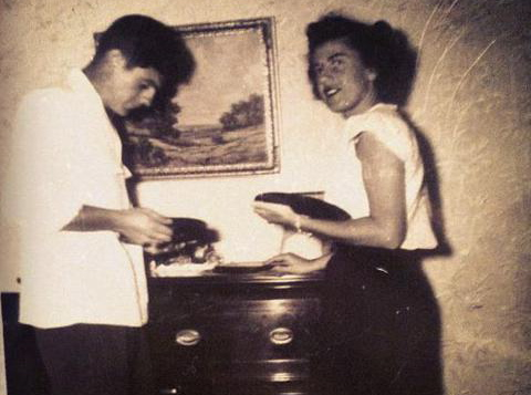 Grandma Norma Grande and her brother, Billy. We don't know what records they are playing.