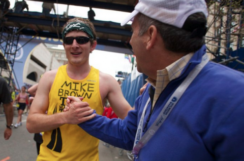 Shaking hands with the Tufts University President Larry Bacow after finishing the Boston Marathon in 2010.