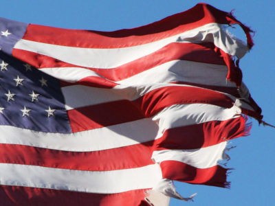 patriotic-waving-tattered-shredding-american-flag-old-glory-the-red-white-and-blue-stars-stripes-that-ragged-old-flag.jpg