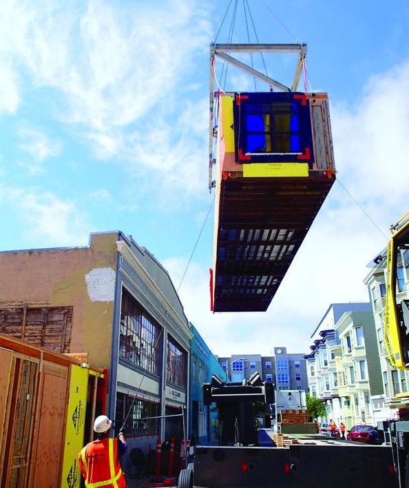 A modular house being moved into place