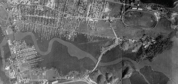 An aerial view of the Martín Peña Canal in the 1930s, showing the extent of mangrove swamps that once lined the canal.