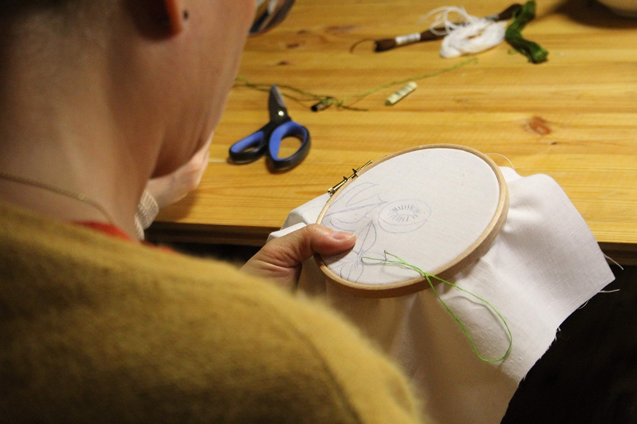 Person doing embroidery