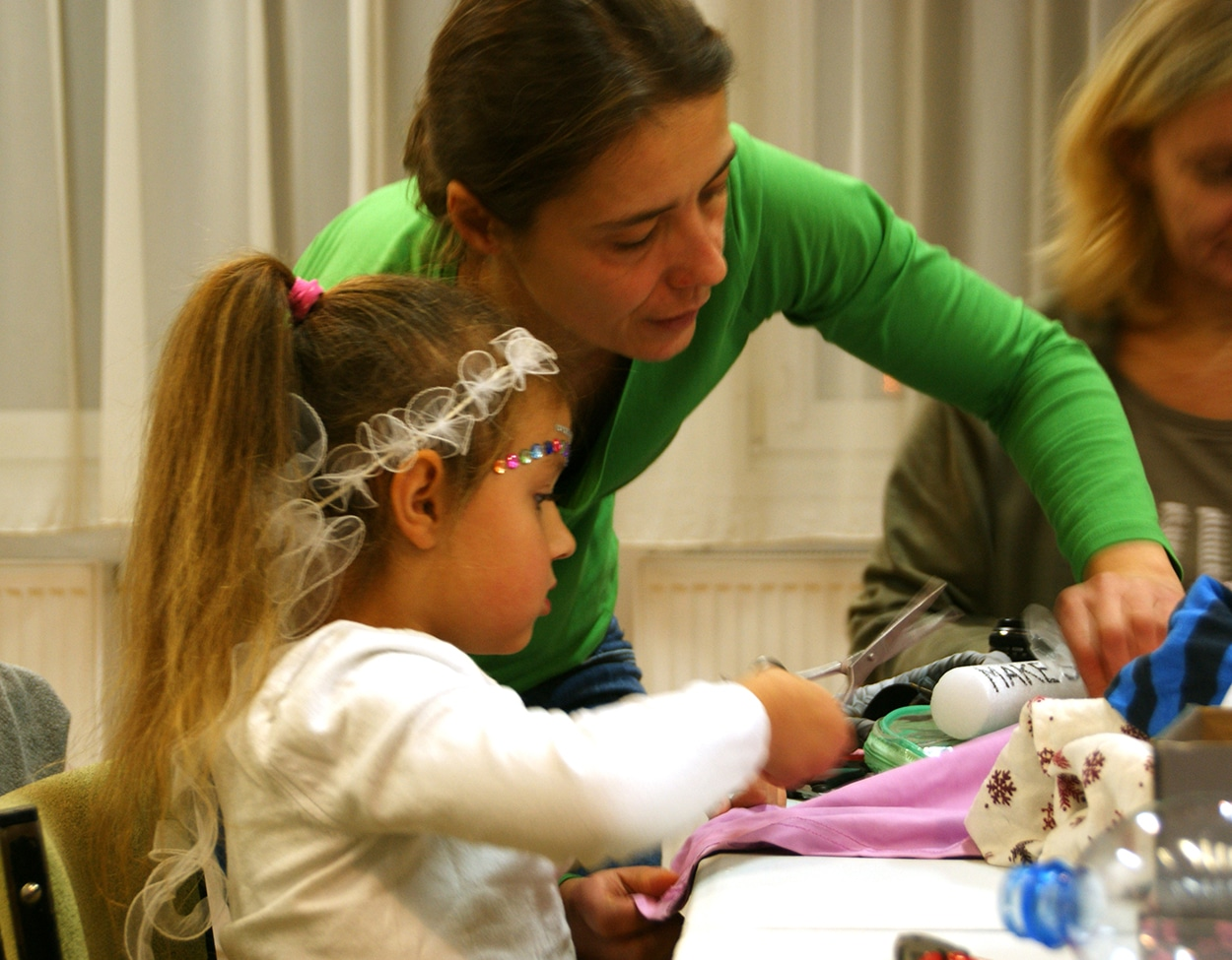 woman and girl doing crafts