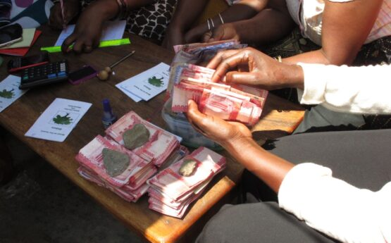 Pooled money is collected and counted. Photo credit: Hugh Allen