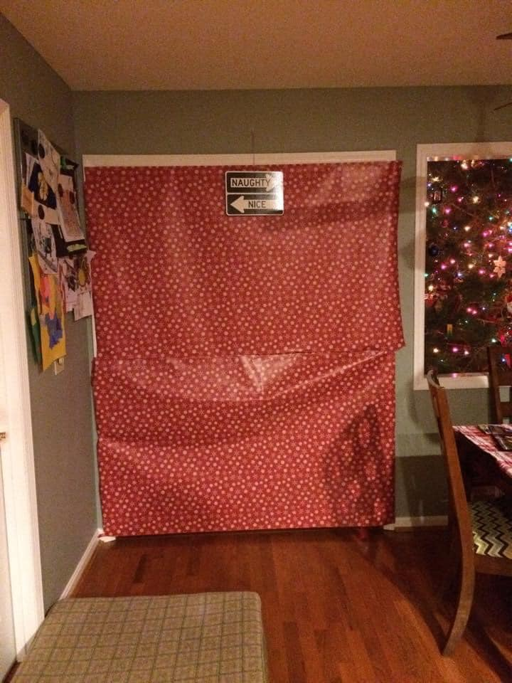 A doorway covered in wrapping paper is one no-spend tradition one family uses during the holiday season. Credit: Amy Lantz