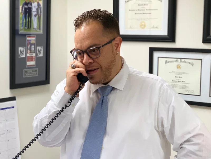 Photo of a man in business attire making a phone call