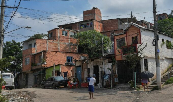 View of the main entrance of Vila Nova Esperanca, a 'green favela' that utilizes the principles of permaculture and fights to be a model of sustainable living (Sao Paulo, Brazil - Feb 2020) Credit: Nelson Almeida - sustainable housing