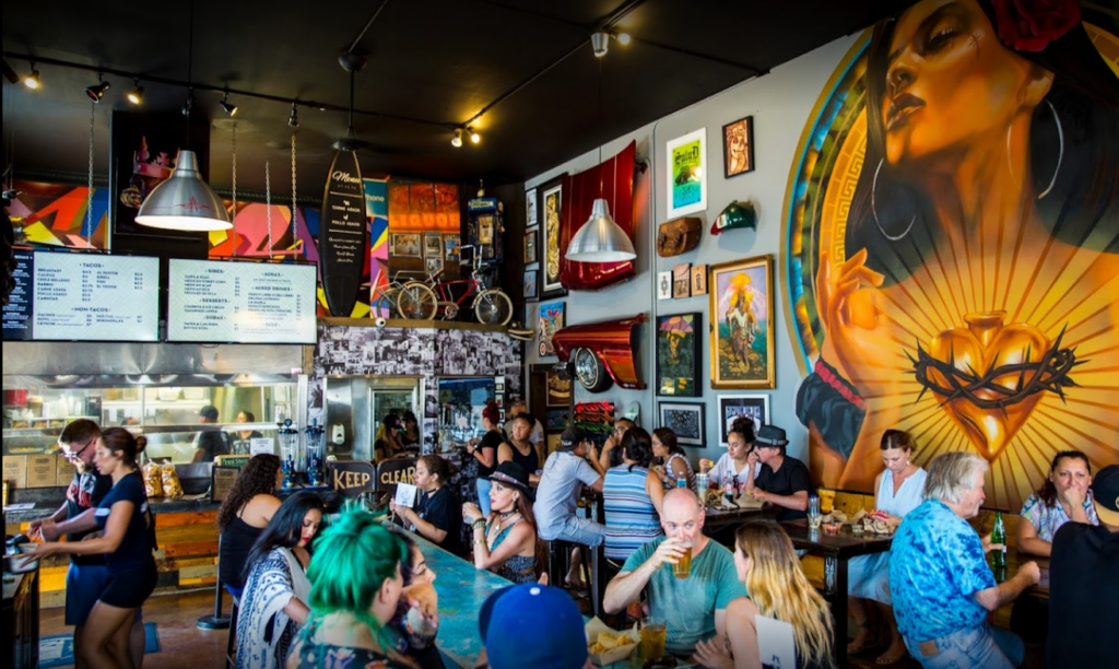 """Patrons dine inside ¡Salud Tacos!, a """" hip, casual Mexican eatery"""" located in San Diego, CA."""
