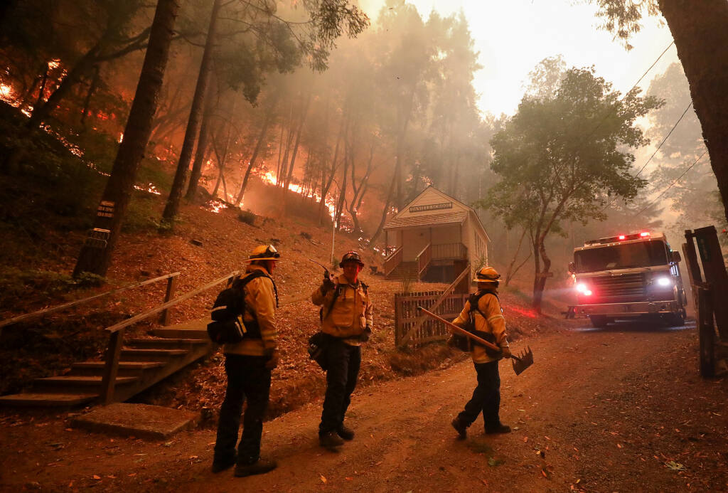 Sonoma Valley firefighters plan their effort to combat a growing wildfire Credit: Christopher Chung
