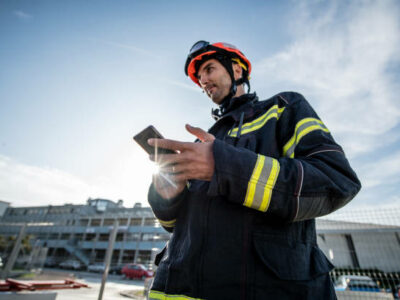 Watch Duty- Firefighters in a rescue operation training, holding a cellphone